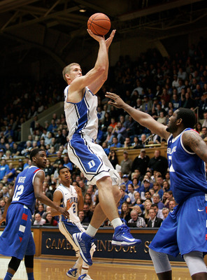 Nov 9, 2012; Durham, NC, USA; Duke Blue Devils forward Mason Plumlee (5) drives against Georgia State Panthers center James Vincent (50) during the second half at Cameron Indoor Stadium.  Mandatory Credit: Mark Dolejs-US PRESSWIRE