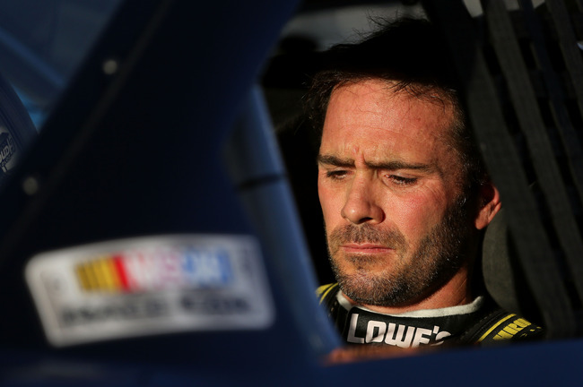 AVONDALE, AZ - NOVEMBER 09:  Jimmie Johnson, driver of the #48 Lowe's/Kobalt Tools Chevrolet, sits in his car during qualifying for the NASCAR Sprint Cup Series AdvoCare 500 at Phoenix International Raceway on November 9, 2012 in Avondale, Arizona.  (Phot