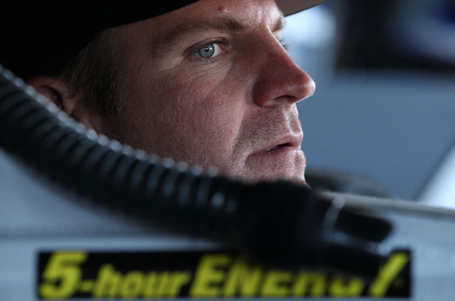 AVONDALE, AZ - NOVEMBER 10:  Clint Bowyer, driver of the #15 5-hour Energy Toyota, sits in his car during practice for the NASCAR Sprint Cup Series AdvoCare 500 at Phoenix International Raceway on November 10, 2012 in Avondale, Arizona.  (Photo by Tyler B