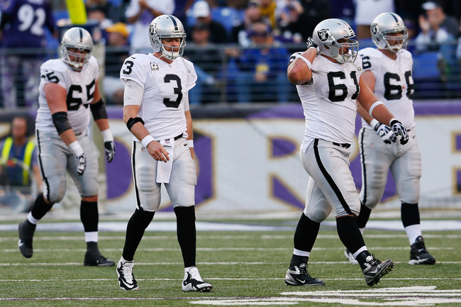 BALTIMORE, MD - NOVEMBER 11: Quarterback Carson Palmer #3 of the Oakland Raiders walks off the field with teammates  Mike Brisiel #65, Stefen Wisniewski #61 and Cooper Carlisle #66 after failing to convert on fourth down during the second half of their 55