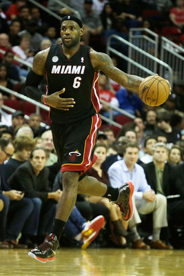 HOUSTON, TX - NOVEMBER 12:  LeBron James #6 of the Miami Heat brings the ball upcourt against the Houston Rockets at the Toyota Center on November 12, 2012 in Houston, Texas. NOTE TO USER: User expressly acknowledges and agrees that, by downloading and or