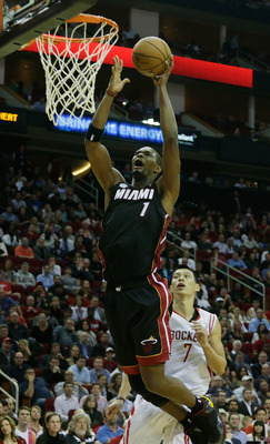HOUSTON, TX - NOVEMBER 12:  Chris Bosh #1 of the Miami Heat drives the ball against Jeremy Lin #7 of the Houston Rockets at the Toyota Center on November 12, 2012 in Houston, Texas. NOTE TO USER: User expressly acknowledges and agrees that, by downloading