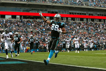 CHARLOTTE, NC - NOVEMBER 11:   Greg Olsen #88 of the Carolina Panthers scores a touchdown against the Denver Broncos during their game at Bank of America Stadium on November 11, 2012 in Charlotte, North Carolina.  (Photo by Streeter Lecka/Getty Images)