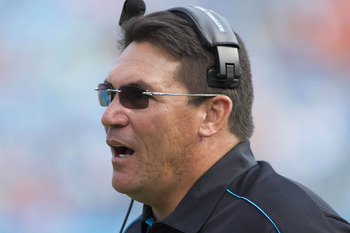 Nov 11, 2012; Charlotte, NC, USA  Carolina Panthers head coach Ron Rivera reacts to a penalty during the first quarter against the Denver Broncos at Bank of America Stadium. Mandatory Credit: Jeremy Brevard-US PRESSWIRE
