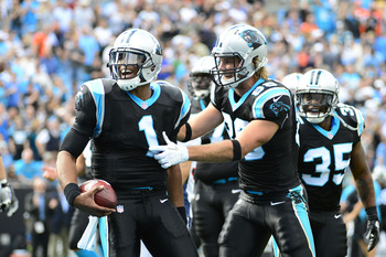 Nov 11, 2012; Charlotte, NC, USA; Carolina Panthers tight end Greg Olsen (88) celebrates a touchdown catch with quarterback Cam Newton (1) in the first quarter at Bank of America Stadium. Mandatory Credit: Bob Donnan-US PRESSWIRE