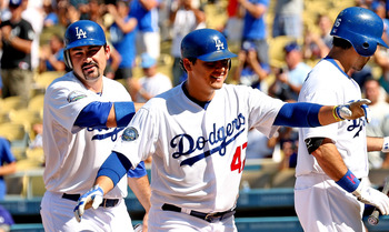 Dodgers INF Luis Cruz celebrates after a big play against the Rockies.