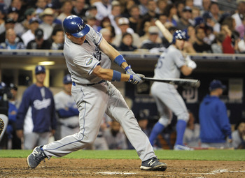 Dodger catcher A.J. Ellis puts a good swing on the ball against the Padres.