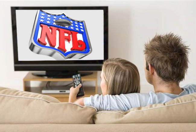 Couple-watching-nfl-on-tv_crop_650x440