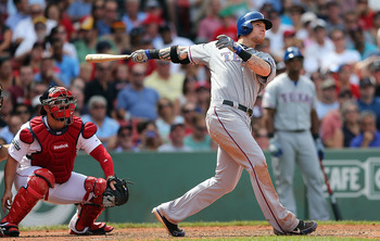 Josh Hamilton watches a long ball he hits at Fenway Park in 2012.