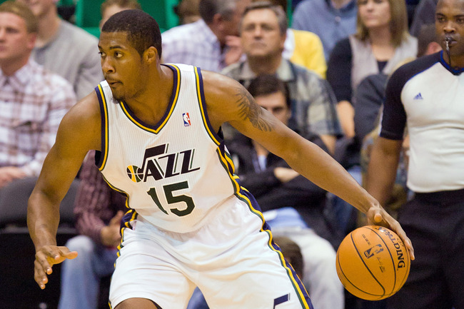 October 25, 2012; Salt Lake City, UT, USA; Utah Jazz power forward Derrick Favors (15) controls the ball against the Portland Trail Blazers during the first half at EnergySolutions Arena. Mandatory Credit: Russ Isabella-US PRESSWIRE