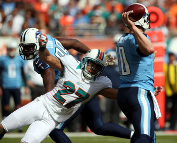 MIAMI GARDENS, FL - NOVEMBER 11:  Quarterback Jake Locker #10 of the Tennessee Titans is sacked by Jimmy Wilson #27 of the Miami Dolphins at Sun Life Stadium on November 11, 2012 in Miami Gardens, Florida.  (Photo by Marc Serota/Getty Images)