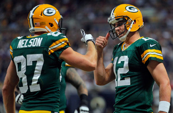 ST LOUIS, MO - OCTOBER 21:  Wide receiver Jordy Nelson #87 of the Green Bay Packers and quarterback Aaron Rodgers #12 of the Green Bay Packers celebrate their three yard touchdown reception against the St. Louis Rams in the first quarter at Edward Jones D