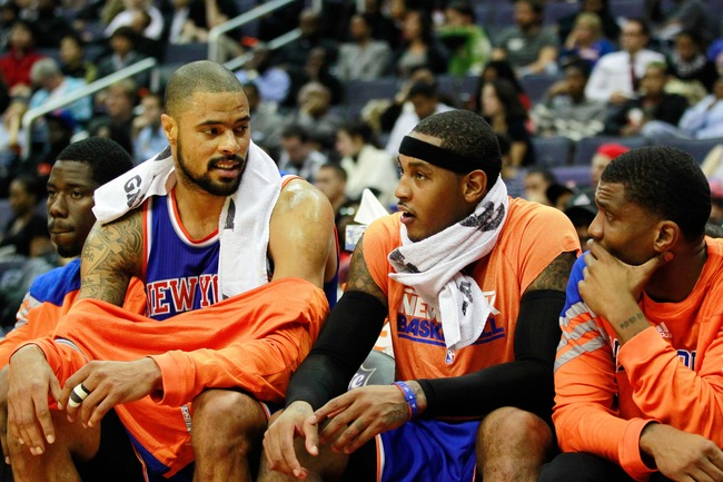 October 11, 2012; Washington, DC, USA; New York Knicks center Tyson Chandler (l) talks with Knicks forward Carmelo Anthony (r) on the bench against the Washington Wizards in the first half at Verizon Center. Mandatory Credit: Geoff Burke-US PRESSWIRE