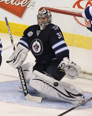 WINNIPEG, CANADA - APRIL 7: Ondrej Pavelec #31 of the Winnipeg Jets watches as the puck goes in on a shot by Steven Stamkos #91of the Tampa Bay Lightning. The goal was his 60th goal  in NHL action at the MTS Centre on April 7, 2012 in Winnipeg, Manitoba, 