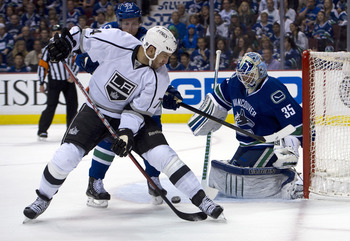 VANCOUVER, CANADA - APRIL 22: Dwight King #74 of the Los Angeles Kings puts a backhand shot on goalie Cory Schneider #35 of the Vancouver Canucks during Game Five of the Western Conference Quarterfinals during the 2012 NHL Stanley Cup Playoffs at Rogers A