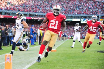 November 11, 2012; San Francisco, CA, USA; San Francisco 49ers running back Frank Gore (21) scores a touchdown against the St. Louis Rams during the fourth quarter at Candlestick Park. The 49ers and the Rams tied 24-24. Mandatory Credit: Kyle Terada-US PR