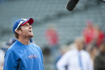ARLINGTON, TX - OCTOBER 5:  Josh Hamilton #32 of the Texas Rangers looks at a camera crews microphone during batting practice before the American League Wild Card game against the /TEAM on October 5, 2012 at the Rangers Ballpark in Arlington, Texas.  (Pho