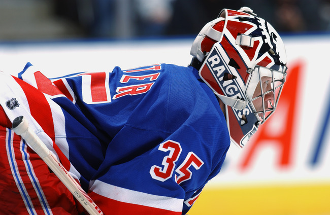 TORONTO - OCTOBER 26:  Goaltender Mike Richter #35 of the New York Rangers looks on against the Toronto Maple Leafs during the NHL game at The Air Canada Centre on October 26, 2002 in Toronto, Ontario.  The Rangers defeated the Maple Leafs 4-3.   (Photo b