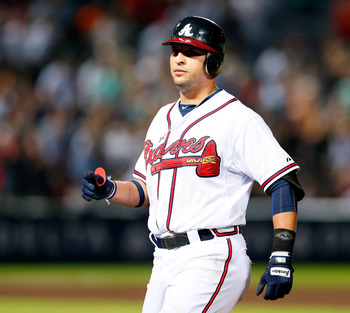 ATLANTA, GA - SEPTEMBER 27:  Martin Prado #14 of the Atlanta Braves reaches first on an error that allows two runs to score in the fourth inning against the Miami Marlins aat Turner Field on September 27, 2012 in Atlanta, Georgia.  (Photo by Kevin C. Cox/