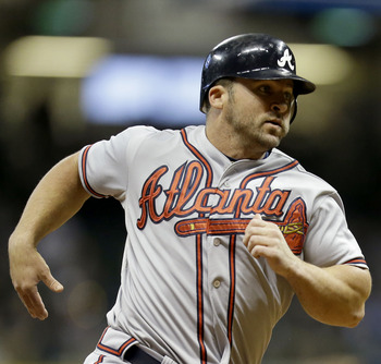 MILWAUKEE, WI - SEPTEMBER 10: Dan Uggla #26 of the Atlanta Braves runs to third base on a single hit by Brian McCann in the top of the fifth inning against the Milwaukee Brewers at Miller Park on September 10, 2012 in Milwaukee, Wisconsin. (Photo by Mike