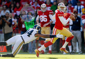 SAN FRANCISCO, CA - NOVEMBER 11: Quarterback Colin Kaepernick #7 of the San Francisco 49ers runs for a first down against defensive end Robert Quinn #94 of the St. Louis Rams in the fourth quarter on November 11, 2012 at Candlestick Park in San Francisco,