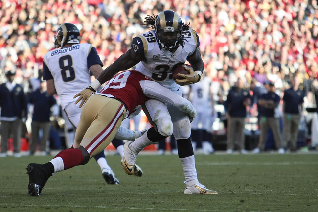 November 11, 2012; San Francisco, CA, USA; San Francisco 49ers outside linebacker Aldon Smith (99) tackles St. Louis Rams running back Steven Jackson (39) during the third quarter at Candlestick Park. The San Francisco 49ers tied the St. Louis Rams 24-24.