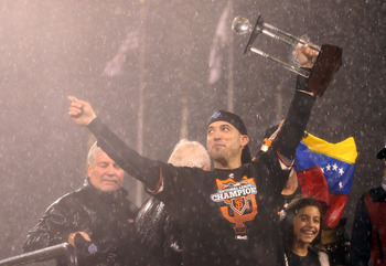 SAN FRANCISCO, CA - OCTOBER 22:  Marco Scutaro #19 of the San Francisco Giants holds up the MVP trophy after the Giants defeat the St. Louis Cardinals 9-0 in Game Seven of the National League Championship Series at AT&T Park on October 22, 2012 in San Fra