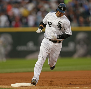 CHICAGO, IL - AUGUST 10: A.J. Pierzynski #12 of the Chicago White Sox runs the bases after hitting his 22nd home run of the year against the Oakland Athletics at U.S. Cellular Field on August 10, 2012 in Chicago, Illinois. (Photo by Jonathan Daniel/Getty