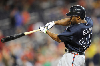 WASHINGTON, DC - JULY 20: Michael Bourn #24 of the Atlanta Braves hits a triple in the ninth inning against the Washington Nationals at Nationals Park on July 20, 2012 in Washington, DC. (Photo by Greg Fiume/Getty Images)