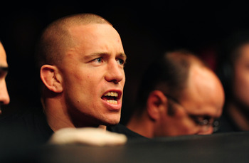 Oct. 29, 2011; Las Vegas, NV, USA; UFC fighter Georges St-Pierre sits cageside during UFC 137 at the Mandalay Bay event center. Mandatory Credit: Mark J. Rebilas-US PRESSWIRE