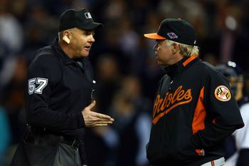 Baltimore Orioles head coach Buck Showalter disputes a call.