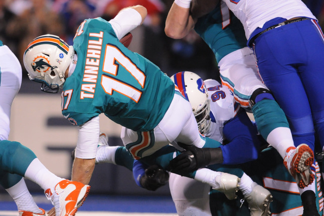 Nov 15, 2012; Orchard Park, NY, USA; Miami Dolphins quarterback Ryan Tannehill (17) is sacked by Buffalo Bills defensive end Mario Williams (94) during the first half of a game at Ralph Wilson Stadium.  Mandatory Credit: Mark Konezny-US PRESSWIRE