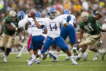 WACO, TX - NOVEMBER 3: Michael Cummings #14 of the University of Kansas Jayhawks throws a pass against the Baylor University Bears on November 3, 2012 at Floyd Casey Stadium in Waco, Texas.  (Photo by Cooper Neill/Getty Images)