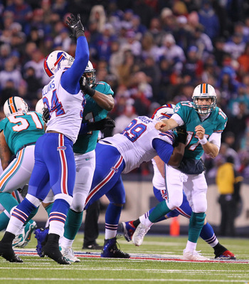 Marcell Dareus puts a hit on Ryan Tannehill