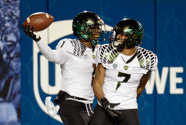 BERKELEY, CA - NOVEMBER 10:  Josh Huff #1 and Keanon Lowe #7 of the Oregon Ducks celebrates after Huff scored on a thirty-four yard touchdown pass against the California Golden Bears in the third quarter of an NCAA College football game at California Memo