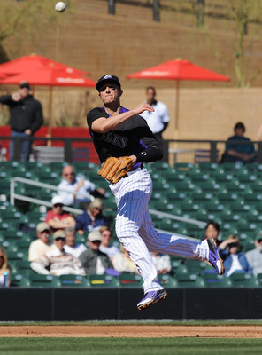 SCOTTSDALE, AZ - FEBRUARY 25:  Troy Tulowitzki #2 of the Colorado Rockies makes a leaping throw against the Texas Rangers at Salt River Field on February 25, 2013 in Scottsdale, Arizona.  (Photo by Norm Hall/Getty Images)