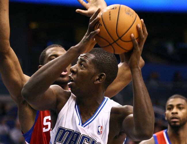 Oct 11, 2012; Orlando, FL, USA; Orlando Magic forward Andrew Nicholson (44) attempts to score as Philadelphia 76ers forward Thaddeus Young (21) defends during the third quarter at Amway Center. Philadelphia defeated Orlando 102-95. Mandatory Credit: Dougl