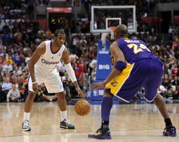 LOS ANGELES, CA - APRIL 04:  Chris Paul #3 of the Los Angeles Clippers dribbles as he is guarded by Kobe Bryant #24 of the Los Angeles Lakers at Staples Center on April 4, 2012 in Los Angeles, California.  NOTE TO USER: User expressly acknowledges and agr
