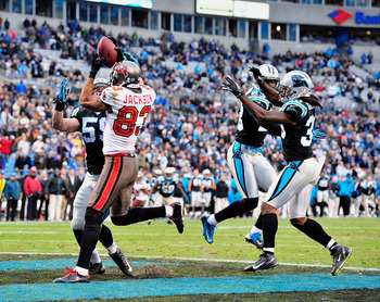CHARLOTTE, NC - NOVEMBER 18:  Vincent Jackson #83 of the Tampa Bay Buccaneers makes a touchdown catch against Luke Kuechly #59 of the Carolina Panthers to help send the game to overtime during play at Bank of America Stadium on November 18, 2012 in Charlo