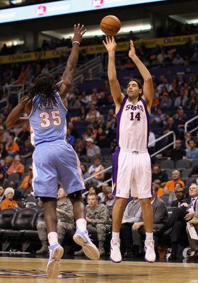 Luis Scola shoots over Kenneth Faried of the Denver Nuggets