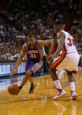 Sebastian Telfair drives against Norris Cole of the Miami Heat