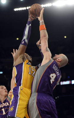 Marcin Gortat blocks Dwight Howard of the Los Angeles Lakers