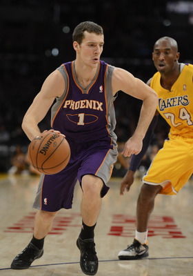 Goran Dragic drives against Kobe Bryant of the Los Angeles Lakers