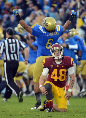 USC K Andre Heidari and UCLA LB Eric Kendricks react after a blocked FG