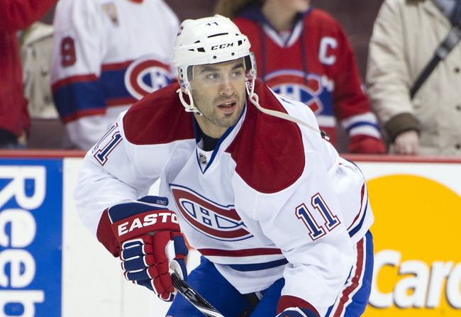 VANCOUVER, CANADA - MARCH 10: Scott Gomez #11 of the Montreal Canadiens looks for a pass during the team warmup prior to NHL action against the Vancouver Canucks on March 10, 2012 at Rogers Arena in Vancouver, British Columbia, Canada.  (Photo by Rich Lam