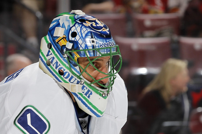 SUNRISE, FL - JANUARY 09: Goaltender Roberto Luongo #1 of the Vancouver Canucks looks up ice during first period action against the Florida Panthers on January 9, 2012 at the BankAtlantic Center in Sunrise, Florida. The Panthers defeated the Canucks 2-1.