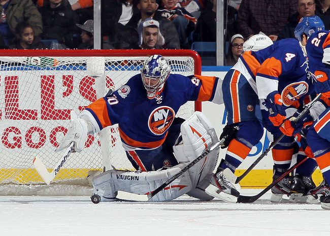 UNIONDALE, NY - FEBRUARY 11:  Evgeni Nabokov #20 of the New York Islanders makes a save against the Los Angeles Kings on February 11, 2012 at Nassau Coliseum in Uniondale, New York. The Islanders defeated the Kings 2-1 in overtime.  (Photo by Jim McIsaac/