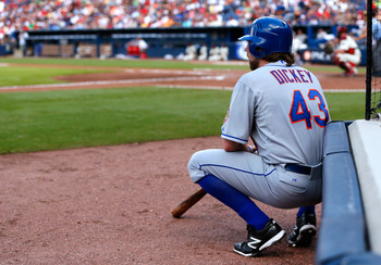 ATLANTA, GA - JULY 14:  R.A. Dickey #43 of the New York Mets waits to bat against the Atlanta Braves at Turner Field on July 14, 2012 in Atlanta, Georgia.  (Photo by Kevin C. Cox/Getty Images)