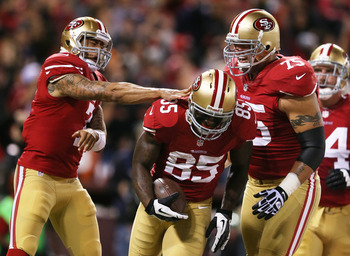 A welcome sight, teammates congratulating Vernon Davis after a touchdown.