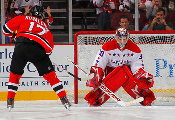 Michal Neuvirth facing Ilya Kovalchuk of the New Jersey Devils in a shootout